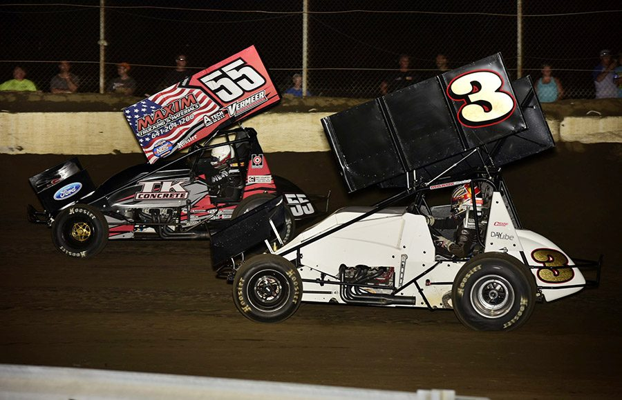 Hunter Schuerenberg (55) races alongside Austin O'Dell during Friday's Morrow Brothers Ford MOWA Sprint Car Series event at Jacksonville Speedway. (Mark Funderburk Photo)