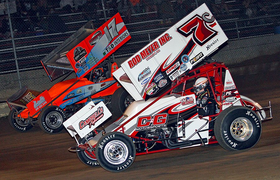 Jared Horstman (17) races around the outside of Phil Gressman during Friday's Great Lakes Super Sprints event at I-96 Speedway. (Jim Denhamer Photo)