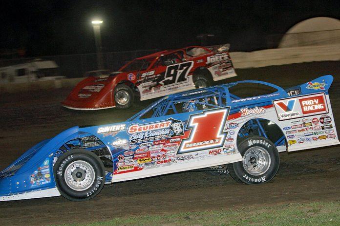 Brandon Sheppard (1) battles Cade Dillard at Davenport Speedway. (Jim DenHamer photo)
