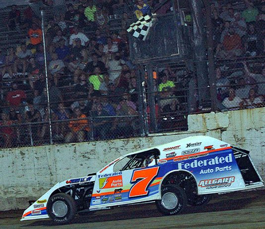 Nick Hoffman takes the checkered flag to win Wednesday's DIRTcar Summit Racing Equipment Modified event at LaSalle Speedway. (Jim Denhamer Photo)