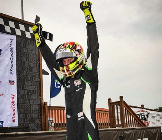 Sting Ray Robb celebrates his maiden Indy Pro 2000 victory Thursday at the Mid-Ohio Sports Car Course.