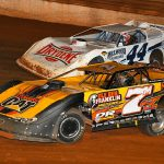 Donald McIntosh (7m) races Chris Madden during Saturday's Schaeffer's Southern Nationals Series finale at Tazewell Speedway. (Michael Moats photo)