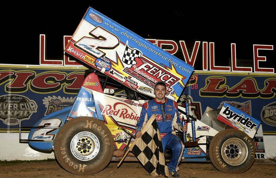 A.J. Flick poses in victory lane following Friday's 410 sprint car program at Lernerville Speedway. (Hein Brothers photo)