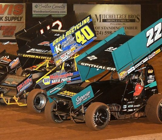 Brandon Spithaler (22) duels with George Hobaugh (40) and Sye Lynch during Friday's 410 sprint car program at Lernerville Speedway. (Hein Brothers photo)