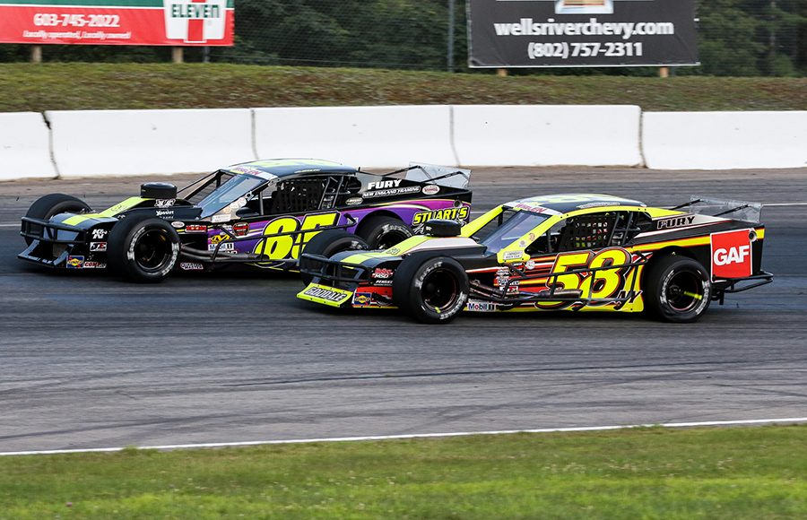 Ron Silk (85) races around the outside of Eric Goodale during Saturday's NASCAR Whelen Modified Tour event at White Mountain Motorsports Park. (Dick Ayers Photo)