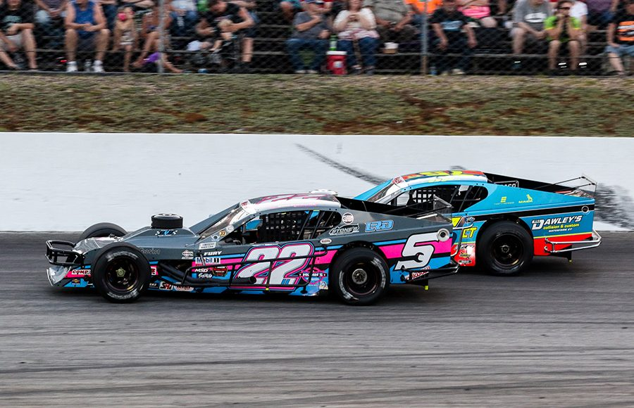 Kyle Bonsignore (22) races under Chris Pasteryak during Saturday's NASCAR Whelen Modified Tour event at White Mountain Motorsports Park. (Dick Ayers Photo)