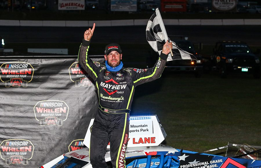 Doug Coby emerges from his car after winning Saturday's NASCAR Whelen Modified Tour event at White Mountain Motorsports Park. (Dick Ayers Photo)