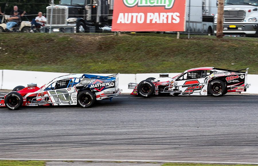 Doug Coby (10) races ahead of Jon McKennedy in a battle for the race lead during Saturday's NASCAR Whelen Modified Tour event at White Mountain Motorsports Park. (Dick Ayers Photo)