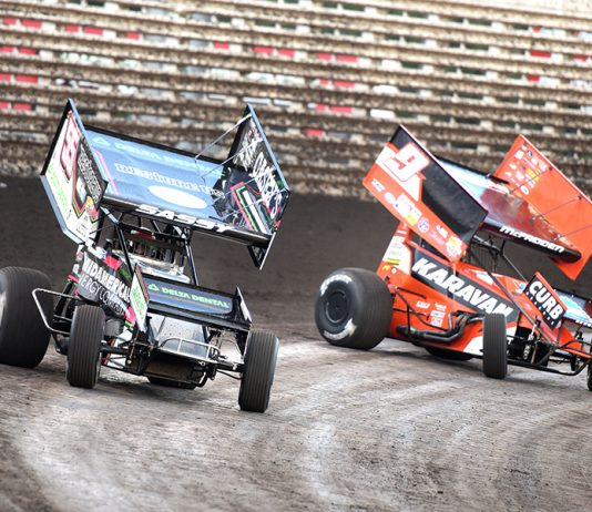 McKenna Haase (55) races ahead of Kasey Kahne Saturday at Knoxville Raceway. (Paul Arch Photo)