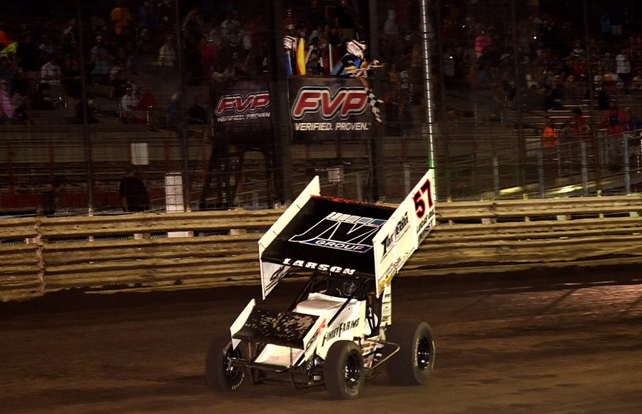 Kyle Larson takes the checkered flag to win Saturday's Ollie's Bargain Outlet All Star Circuit of Champions event at Knoxville Raceway. (Paul Arch Photo)
