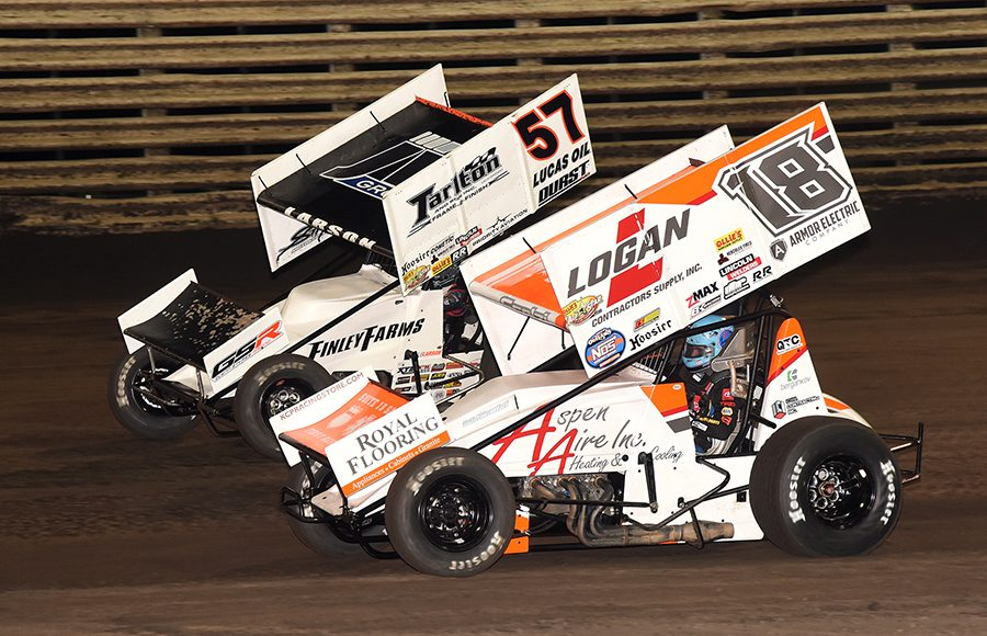Gio Scelzi (18) races under Kyle Larson during Saturday's Ollie's Bargain Outlet All Star Circuit of Champions event at Knoxville Raceway. (Paul Arch Photo)