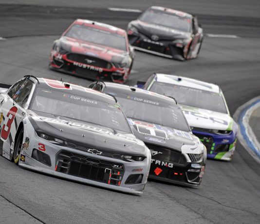 Austin Dillon (3) battles Kevin Harvick (4) during Sunday's NASCAR Cup Series event at New Hampshire Motor Speedway. (HHP/AlanMarler Photo)