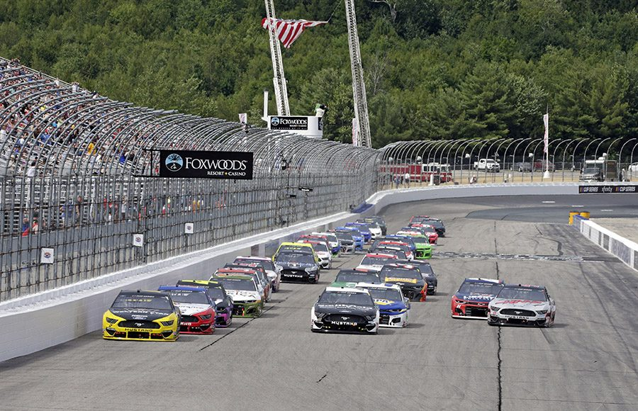 Drivers battle for position during a restart Sunday at New Hampshire Motor Speedway. (HHP/AlanMarler Photo)
