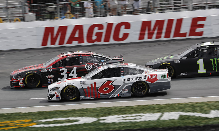 David Ragan (34), Ryan Newman (6) and Kurt Busch battle for position during Sunday's NASCAR Cup Series event at New Hampshire Motor Speedway. (HHP/Andrew Coppley Photo)