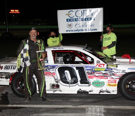 Mike Martin celebrates his victory in the Myers Container Service Triple Crown Series event on Cody Chevrolet-Cadillac Night. (Alan Ward photo)