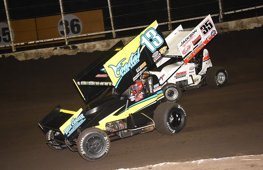 Paul McMahan (13) races under Skylar Prohaska during Sunday's Ollie's Bargain Outlet All Star Circuit of Champions event at Huset's Speedway. (Paul Arch Photo)
