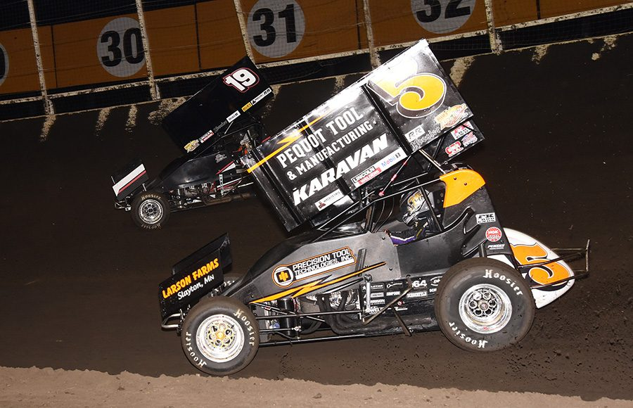Ian Madsen (5) chases Paige Polyak during Sunday's Ollie's Bargain Outlet All Star Circuit of Champions event at Huset's Speedway. (Paul Arch Photo)