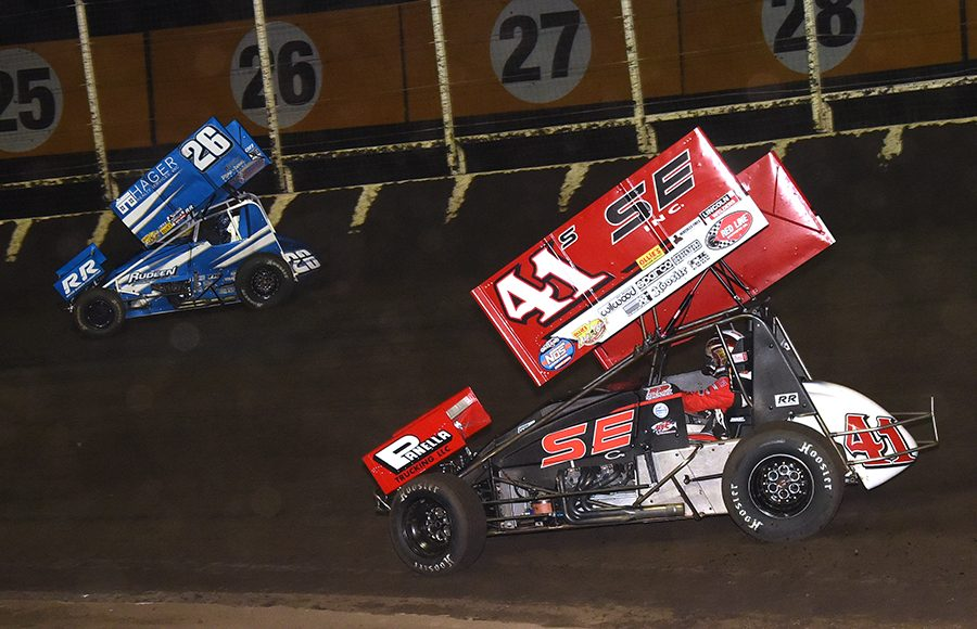 Dominic Scelzi (41) chases race leader Cory Eliason during Sunday's Ollie's Bargain Outlet All Star Circuit of Champions event at Huset's Speedway. (Paul Arch Photo)