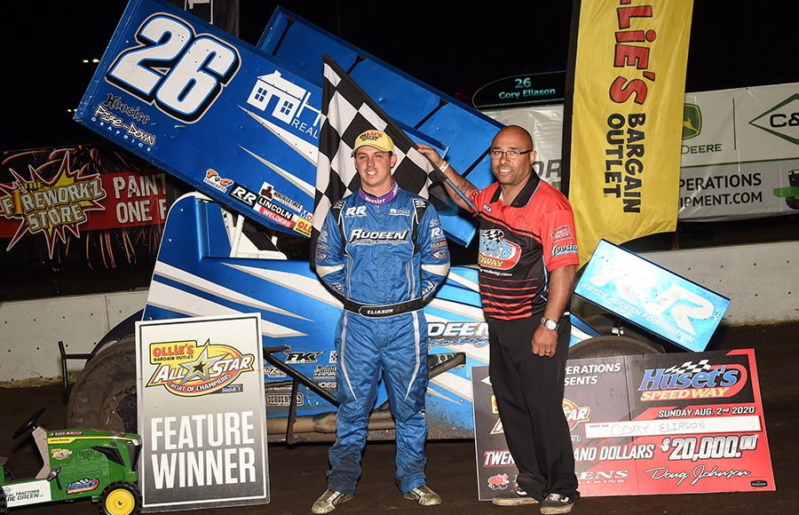 Cory Eliason poses in victory lane after winning Sunday's Ollie's Bargain Outlet All Star Circuit of Champions feature at Huset's Speedway. (Paul Arch Photo)