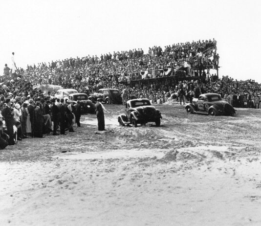A huge crowd was on hand to watch the first organized stock car race to be held on the Daytona Beach Road Course in 1936. Despite the overflow of fans, Daytona Beach city officials estimated they lost around $20,000 staging the event. (ISC Archives via Getty Images)
