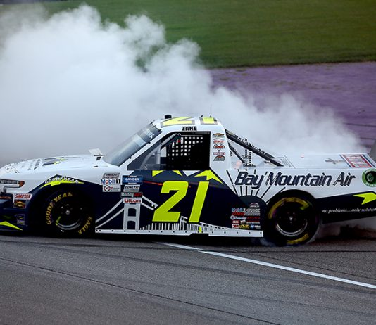 Zane Smith celebrates with a burnout after winning his first NASCAR Gander RV & Outdoors Truck Series race Friday at Michigan Int'l Speedway. (Brian Lawdermilk/Getty Images Photo)