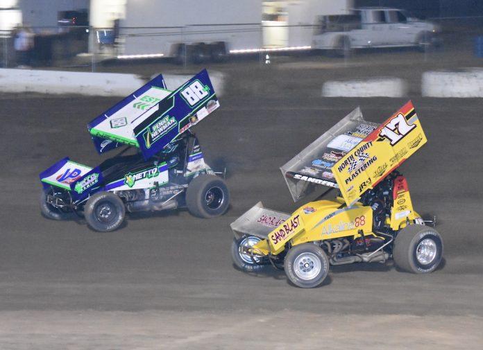Justin Sanders (17) battles D.J. Netto at Ocean Speedway. (Joe Shivak photo)