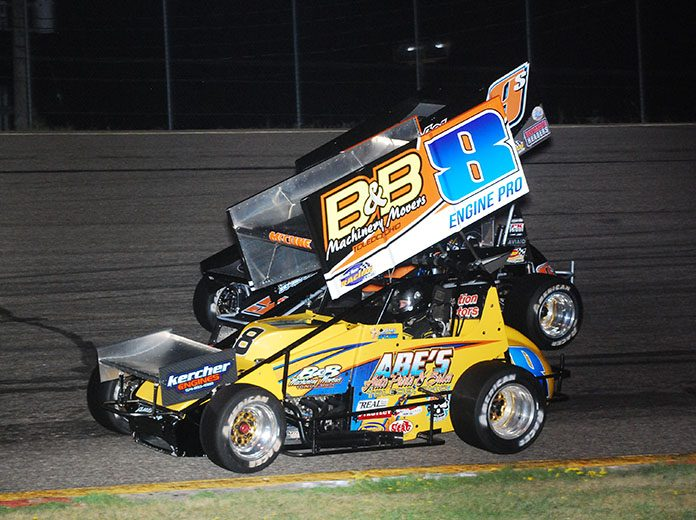Anthony McCune (8) battles Charlie Schultz during Friday's Must See Racing Sprint Car Series event at Golden Sands Speedway. (David Sink Photo)