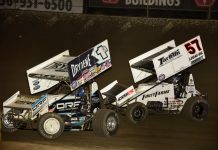 Kyle Larson (57) battles Jacob Allen for the lead at Federated Auto Parts Raceway at I-55. (Mark Funderburk photo)