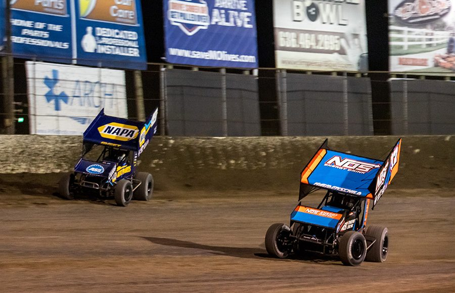 Sheldon Haudenschild (17) battles Brad Sweet during Friday's World of Outlaws NOS Energy Drink Sprint Car Series feature at Federated Auto Parts Raceway at I-55. (Brad Plant Photo)