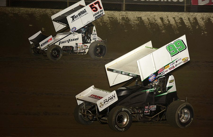 Skylar Gee (99) races alongside Kyle Larson during Friday's World of Outlaws NOS Energy Drink Sprint Car Series feature at Federated Auto Parts Raceway at I-55. (Mark Funderburk Photo)