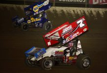 Jason Sides (7s) races under Brad Sweet during Friday's World of Outlaws NOS Energy Drink Sprint Car Series feature at Federated Auto Parts Raceway at I-55. (Mark Funderburk Photo)