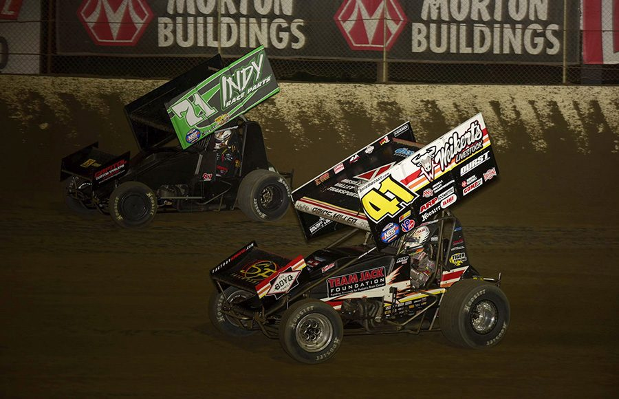 Parker Price-Miller (41) battles Shane Stewart during Friday's World of Outlaws NOS Energy Drink Sprint Car Series feature at Federated Auto Parts Raceway at I-55. (Mark Funderburk Photo)