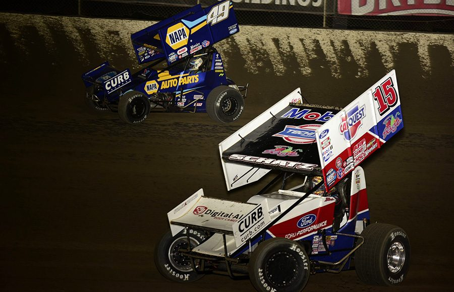 Donny Schatz (15) races under Brad Sweet during Friday's World of Outlaws NOS Energy Drink Sprint Car Series feature at Federated Auto Parts Raceway at I-55. (Mark Funderburk Photo)