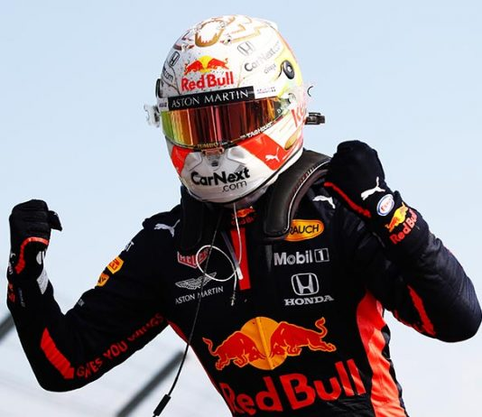 Max Verstappen celebrates after winning Sunday's 70th Anniversary Grand Prix at the Silverstone Circuit. (Bryn Lennon/Getty Images Photo)