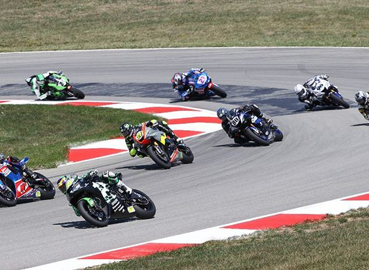 Riders battle for position during Sunday's MotoAmerica Supersport race at Pittsburgh Int'l Race Complex. (Brian J. Nelson Photo)