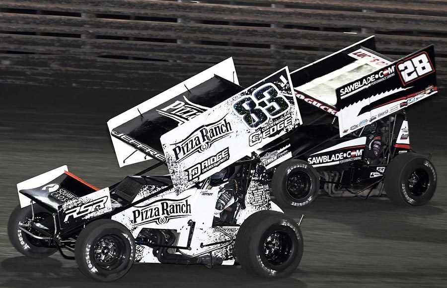 Lynton Jeffrey (83) battles Scott Bogucki during Friday's 360 Knoxville Nationals preliminary event at Knoxville Raceway. (Frank Smith Photo)