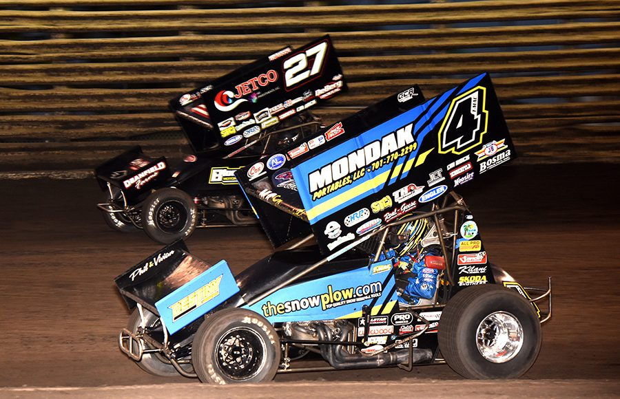 Terry McCarl (4) battles his son, Carson McCarl, during Friday's 360 Knoxville Nationals preliminary event at Knoxville Raceway. (Paul Arch Photo)