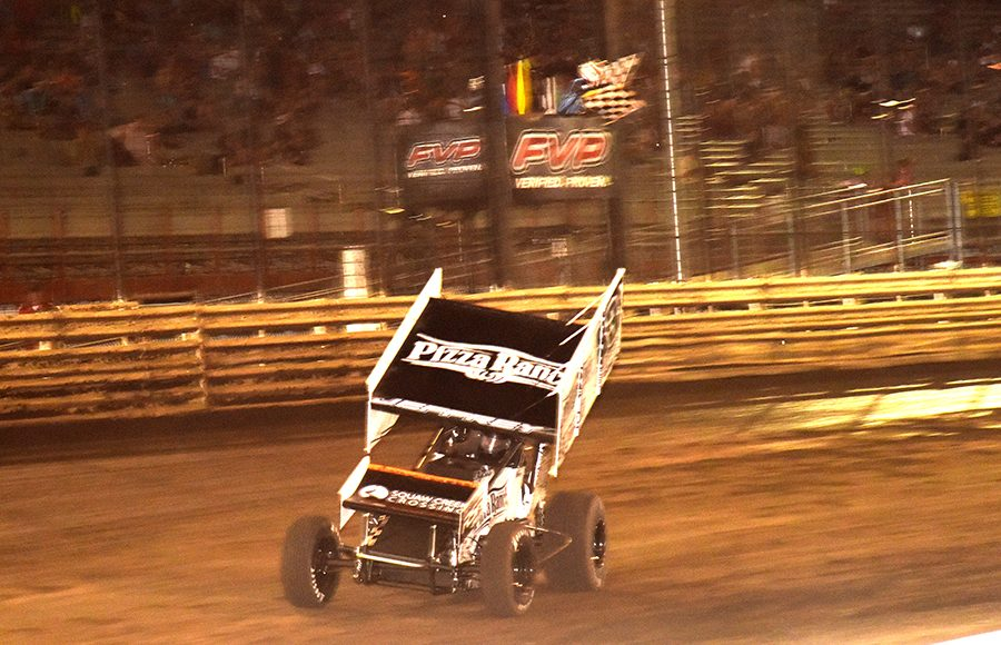 Lynton Jeffrey takes the checkered flag to win Friday's 360 Knoxville Nationals event at Knoxville Raceway. (Paul Arch Photo)