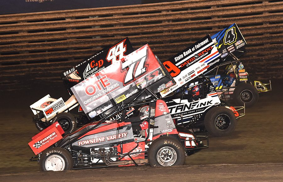 Alex Hill (77), Chris Martin (44), Matt Juhl (09) and Terry McCarl battle for position during Friday's 360 Knoxville Nationals event at Knoxville Raceway. (Paul Arch Photo)