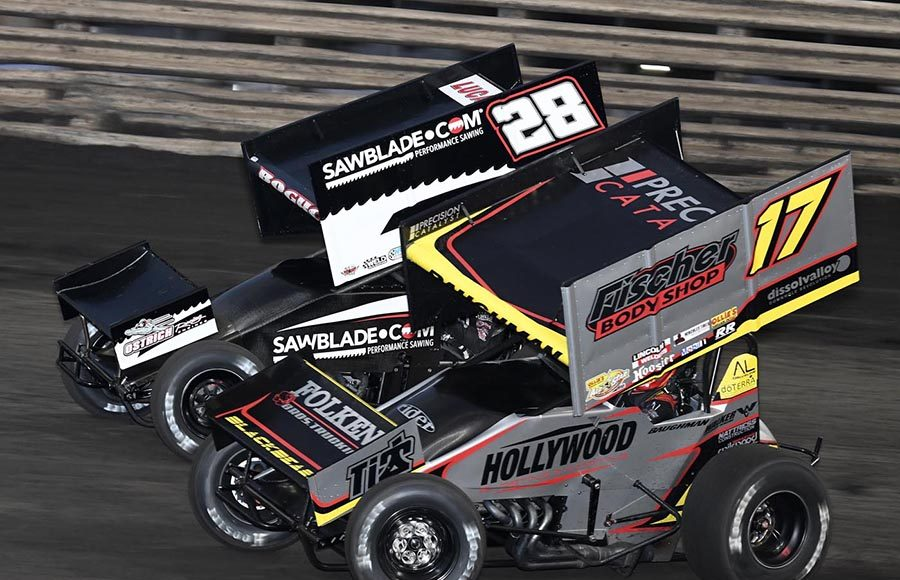 Josh Baughman (17) battles Scott Bogucki during a heat race as part of Friday's 360 Knoxville Nationals preliminary event at Knoxville Raceway. (Frank Smith Photo)