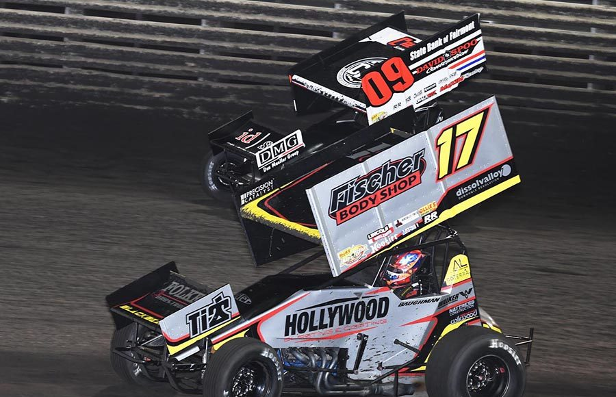 Josh Baughman (17) races under Matt Juhl during Friday's 360 Knoxville Nationals preliminary event at Knoxville Raceway. (Frank Smith Photo)