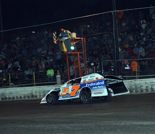 Nick Hoffman takes the checkered flag to win Tuesday's DIRTcar Summit Racing Equipment Modified Nationals feature at Sycamore Speedway. (Jim Denhamer Photo)