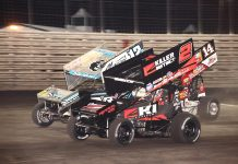 Kerry Madsen (2) battles Joey Saldana (12n) and Tim Shaffer during Saturday's 360 Knoxville Nationals finale at Knoxville Raceway. (Richard Bales Photo)