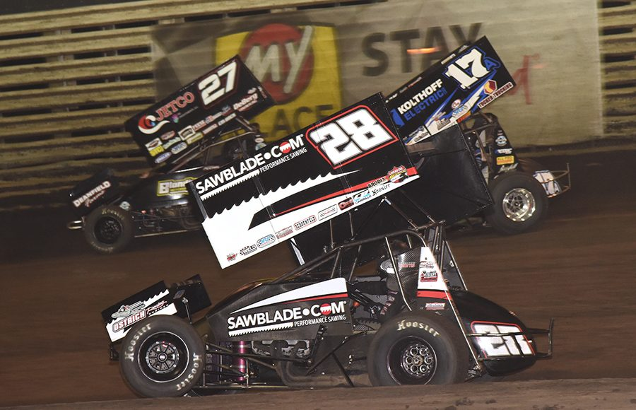 Scott Bogucki (28), Carson McCarl (27) and Austin McCarl battle for position during Saturday's 360 Knoxville Nationals finale at Knoxville Raceway. (Paul Arch Photo)