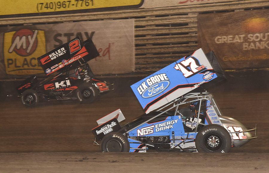 Shane Golobic (17) chases Kerry Madsen during Saturday's 360 Knoxville Nationals finale at Knoxville Raceway. (Paul Arch Photo)