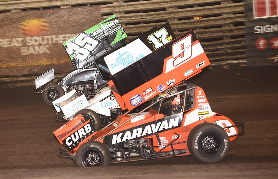 James McFadden (9), Harli White (17) and Josh Higday battle during the 360 Knoxville Nationals B Main Saturday at Knoxville Raceway. (Paul Arch Photo)