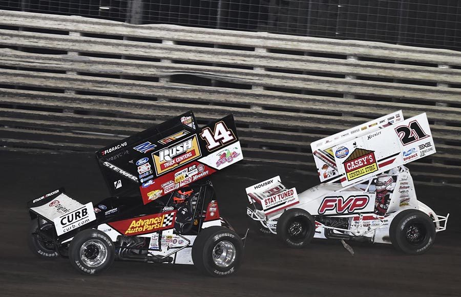 Tim Shaffer (14) races ahead of Brian Brown during Saturday's 360 Knoxville Nationals finale at Knoxville Raceway. (Frank Smith Photo)
