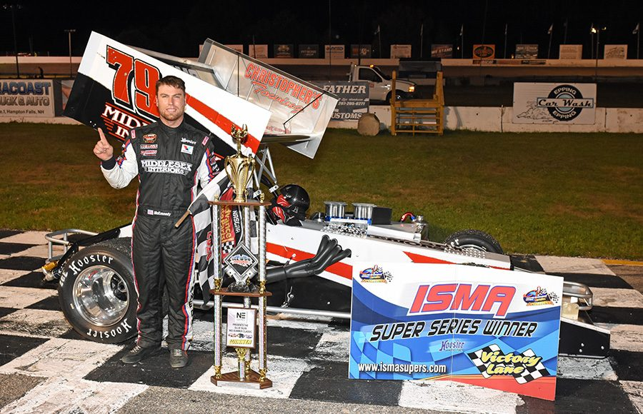 Jon McKennedy stands in victory lane after winning Friday's ISMA Ollie Silva Memorial 75 at Lee USA Speedway. (Jim Feeney Photo)