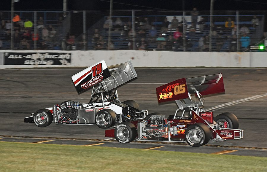 Jon McKennedy (79) leads Jeff Abold during Friday's ISMA Ollie Silva 75 at Lee USA Speedway. (Jim Feeney Photo)