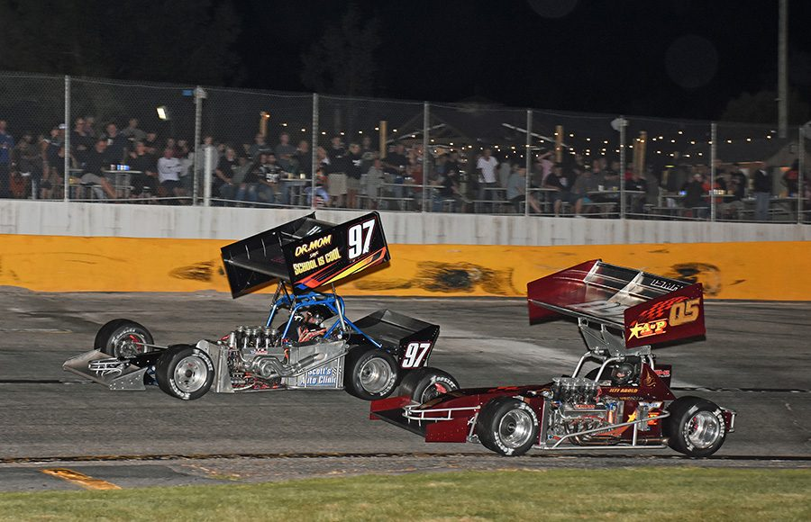 Russ Wood (97) races ahead of Jeff Abold during Friday's ISMA Ollie Silva 75 at Lee USA Speedway. (Jim Feeney Photo)